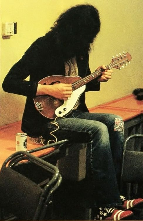 Jimmy Page of Led Zeppelin playing mandolin