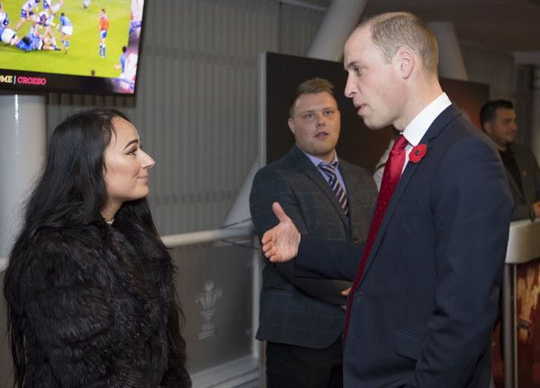 Prince William Photos - Prince William, Duke of Cambridge, meets Kira Philpott, a WRU Coach Core mentor, during the Wales v Australia Autumn International rugby match at the Principality Stadium on November 11, 2017 in Cardiff, Wales. The Duke of Cambridge is a Patron of the Welsh Rugby Union (WRU), taking over the role from Her Majesty The Queen in 2016. - The Duke of Cambridge Attends Wales V Australia Rugby Match