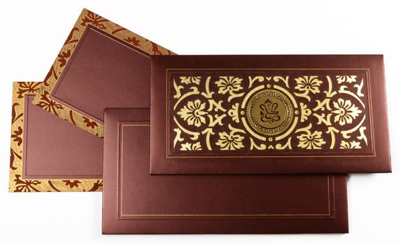 This Hardbound Wedding Card Has Paisley Design Cut In LASER All Over The Front And Line With Gold Paper