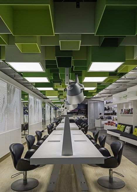 Green boxes cover the ceiling of Clip hair salon by Sweco Architects