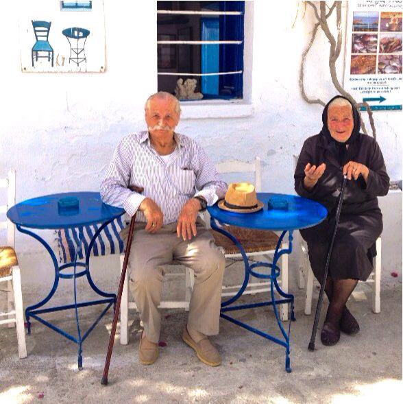 Greek Yiayia & Pappou taking a break at a kafeneion- Schinoussa - Greece