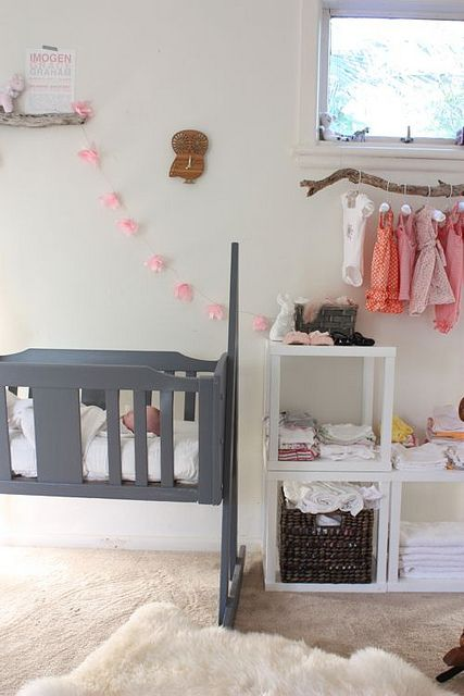 grey and pink nursery - love the branch for hanging clothes.