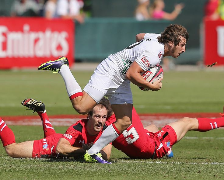Dan Bibby of England leaves Ashley Evand and Lee Williams of Wales in his wake in Dubai, HSBC Sevens World Series, The Sevens stadium, Dubai...