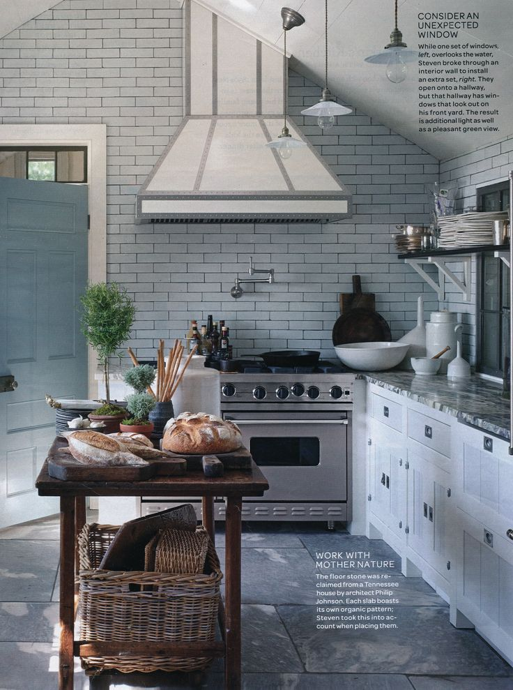 sleek kitchen with organic stone floors #camillestyles #stainlesssteel #marthastewart