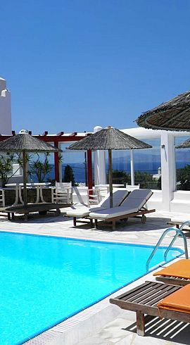 Sea views and sunloungers by the swimming pool at the Anastasios Sevasti Hotel in Mykonos. A lovely hotel on the Greek Islands