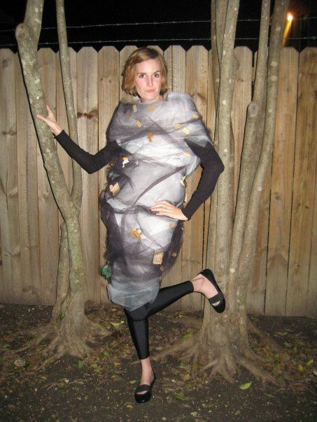 My tornado costume made out of a base of felt, covered in white and then black tulle. Covered in miniature farm animals and dollhouse fences and shingles and railroad trees, etc. Easy!