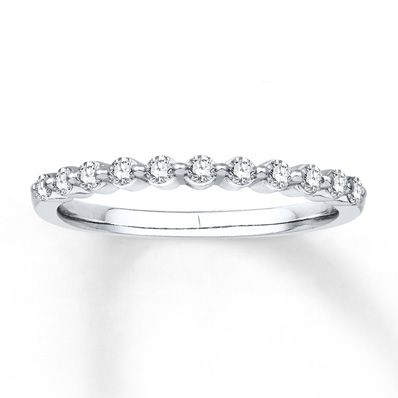 Round diamonds form a sparkling row in this lovely anniversary band for her. Crafted in 14K white gold, the ring has a total diamond weight of 1/4 carat. Diamond Total Carat Weight may range from .23 - .28 carats.