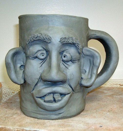 Hand built face mug using slab construction-unfired | ArtNfusion