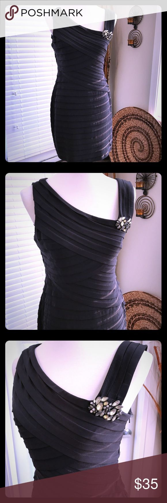 Classy Evening Mini-Dress For the sophisticated socialite. Material stretches very nicely over curves. Dress is lined and zips on the side. It's a petite; however it will fit a regular size 10-12. Xscape Dresses Mini