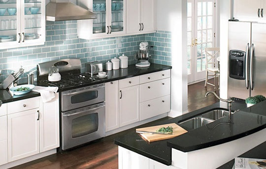 White cabinets black countertop blue backsplash for Home depot kitchen designs