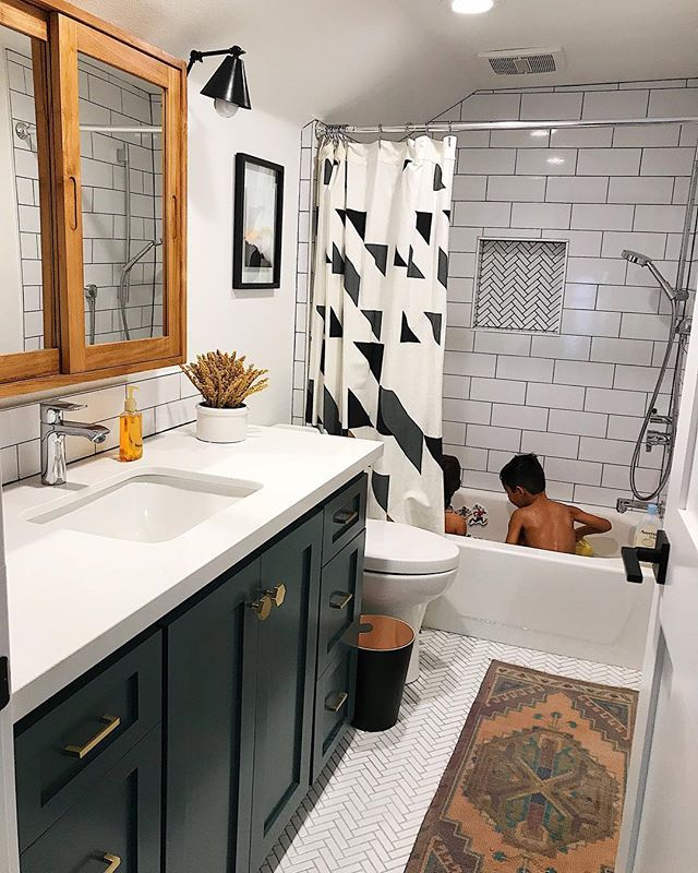 Modern Kids Bathroom With A Dark Green Vanity And Wood Medicine