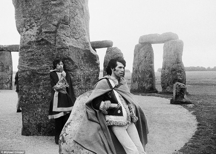 Band of brothers: Rare photos capturing extraordinary bond between Mick Jagger and Keith Richards at height of Rolling Stones' Sixties fame to go on display.  Mick Jagger and Keith Richards pose at Stonehenge in 1967 in capes and fashion that reflects the psychedelic era