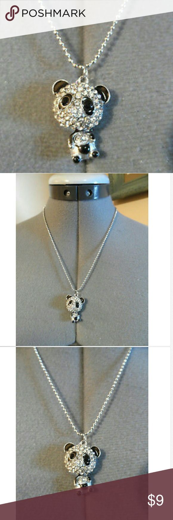 "New RHINESTONE PANDA BEAR Necklace Silver Black Individual monitors may display slightly different colors or hues...   NEW IN FACTORY PACKAGE-  PANDA BEAR Necklace   NECKLACE: approximately 20"", 1mm wide CLOSURE: Clip clasp Pendant: About 1.5""x1"" Costume jewelry Cute little Panda Bear charm encrusted with Rhinestones Dog tag style bead necklace Charm is hollow and bobble head style NEW NEW NEW! unbranded Jewelry Necklaces"