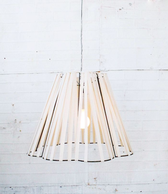 Bright Idea: 9 Surprising Lampshade Alternatives via @MyDomaine - this idea might look cool with bungee cords.