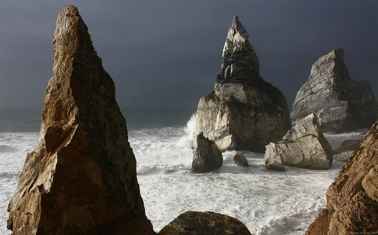 Storm approaching the titanic stones in the Ursa beach