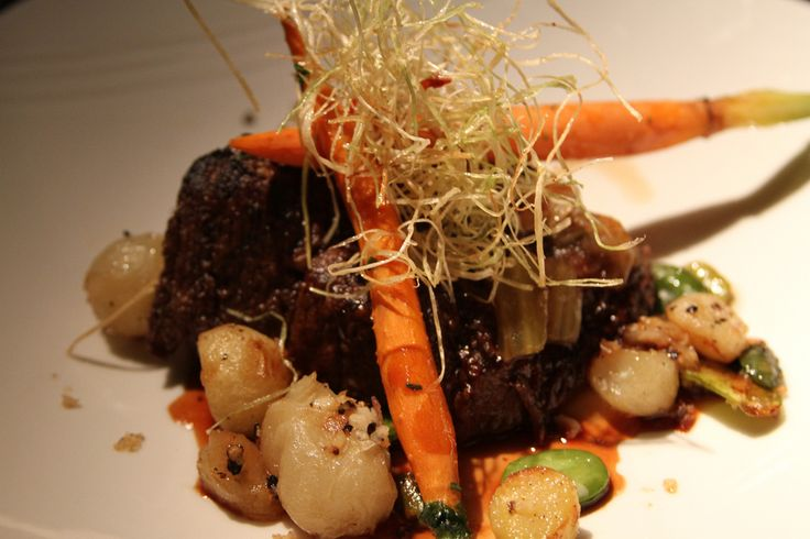 https://flic.kr/p/8FFhcE | Olde English Boneless Braised Beef | Slow-cooked Angus rib meat in Port wine veal essence, served with fresh fava, cherry tomato, glazed carrot, roasted potato, Cipollini onion and frizzled leeks