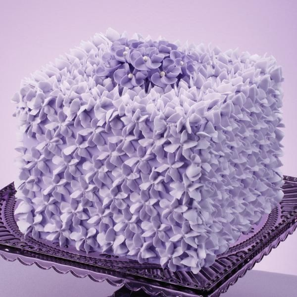 Covered with Wilton Decorating Tip 2D stars all over and drop flowers on top, this square cake ...