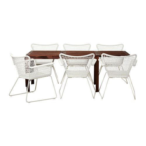 Ikea Hogsten chairs around a wood table. I would like this inside. Although the shape could make them awkward to use.