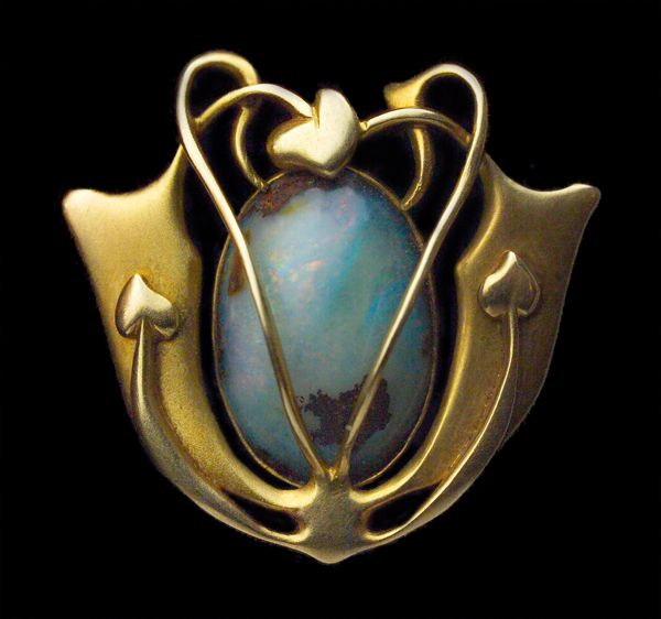 Gold brooch with opal cabochon by Archibald Knox for Liberty & Co., British, c. 1900.