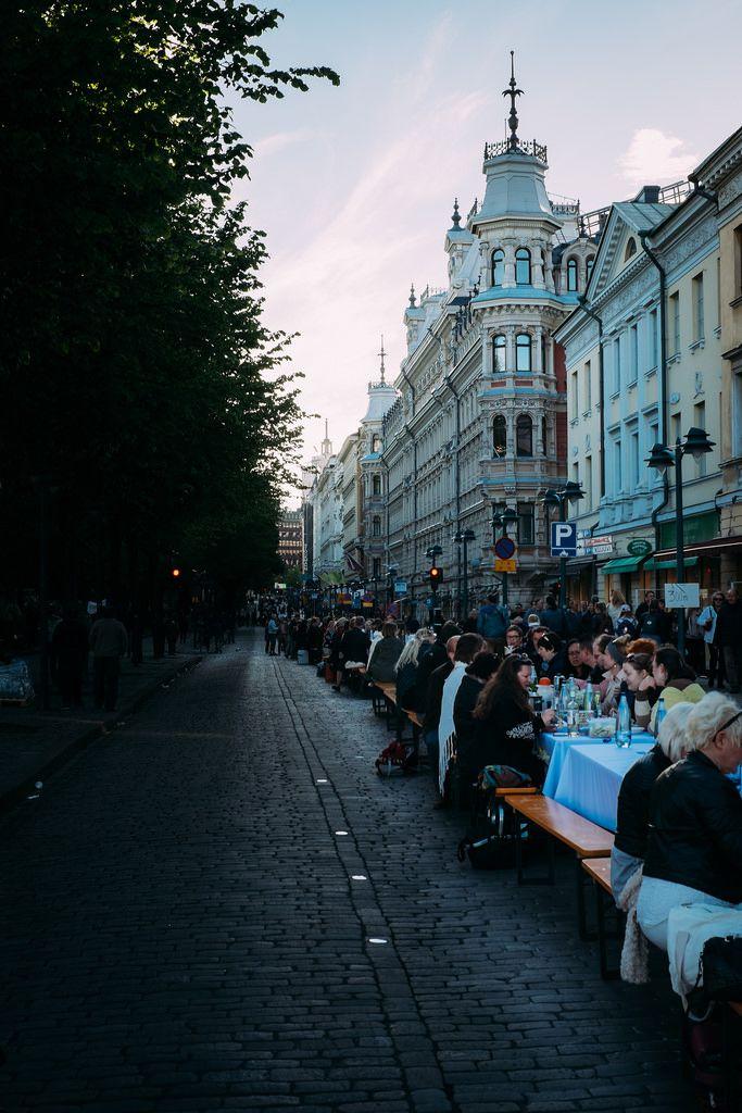 People eating dinner on the North Esplanade. Helsinki.