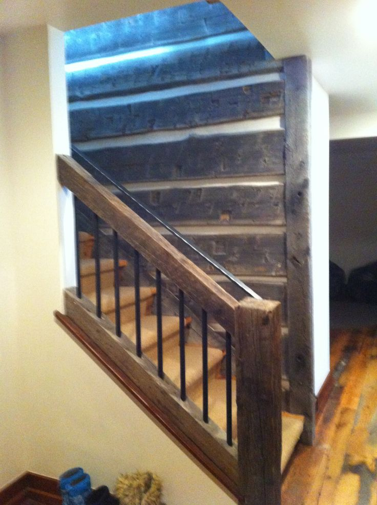 Reclaimed timber railing and posts and black coated steel balusters are also found on the lower landing.