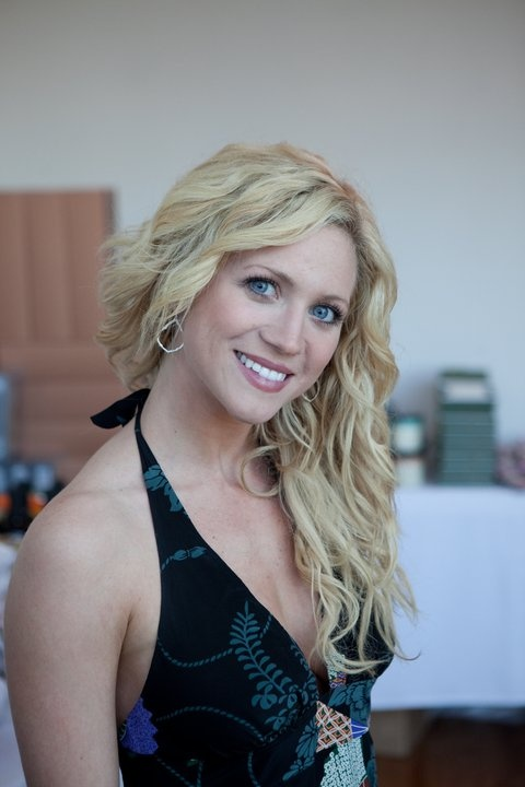Check out Brittany Snow wearing Ashley Morgan's silver lotus leaf frame earrings.