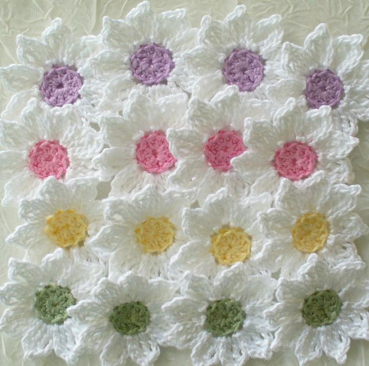 Fresh as a Daisy - Crochet Flowers, Appliques, I can see this as a pillow where only the centre of the flower is anchored to the backing.