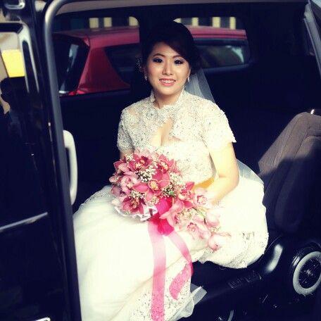 Pink cymbidiums handbouquet on Benny & Dian wedding
