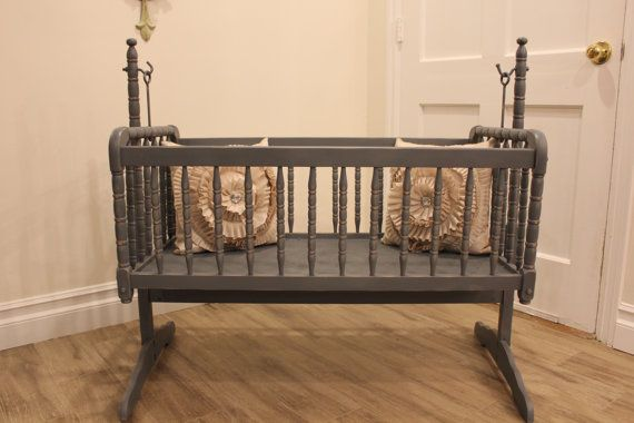 Vintage Jenny Lind cradle bassinet. Not quite sure why I locked onto the rustic look. Just seems like your kid'll be too tough for lambs and little yellow birdies. Rustic cowboy seemed the way to go.