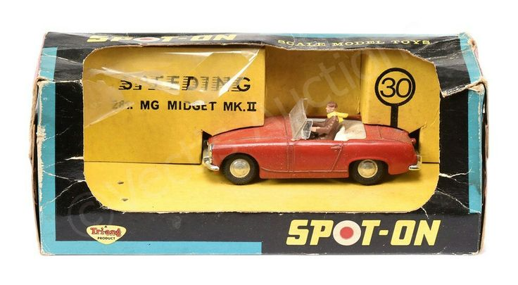 Spot On No.281 MG Midget Sports Car - red, off-white interior with figure driver, cast spun hubs - overall condition is generally Excellent (although requires attention in cleaning) in Fair window box.
