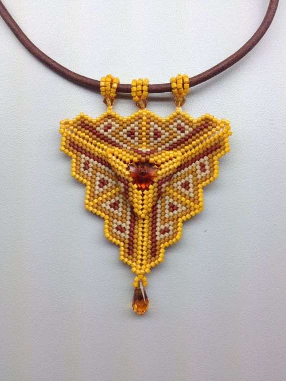 Peyote stitched triangle pendant by BeadSplashHCJ on Etsy, $50.00