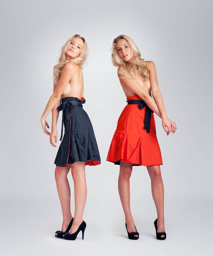Jolier Lily black-orange. Double side wrap skirt with black ribbon belt. By simply turning the skirt inside out you can change the colour from office to party from casual to outstanding! Buy online at www.jolier.com