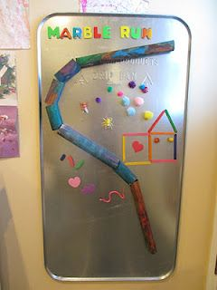 A giant magnet board with a marble run.  Very easy to make, and so many ways to play