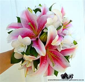 Stargazer lily bouquet accented with touches of white dendrobium orchids.