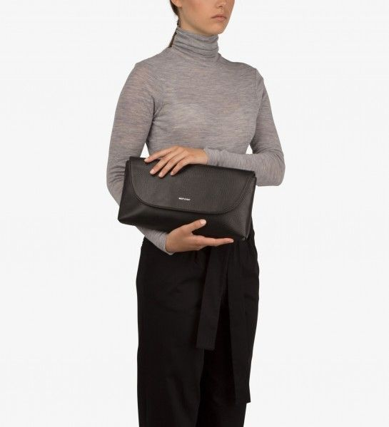 "CHARLOTTE #CLUTCH from the Dwell Collection by Matt & Nat. Oversized clutch with hidden magnetic flap and interior zipper. Interior: Interior: zipper pocket, smartphone pocket, logo-embossed Dwell tag. 100% #recycled nylon lining. Dimensions: 12.5"" x 7"" x 1.5"" #vegan #leather"