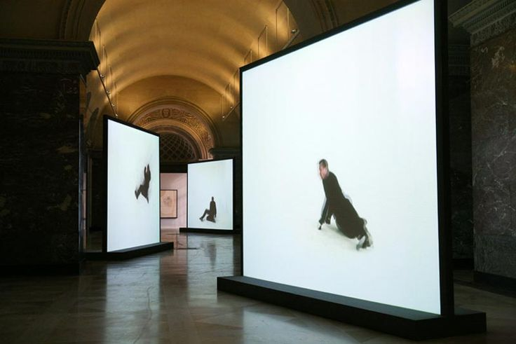 Peter Welz retranslation | final unfinished portrait (francis bacon) | figure inscribing figure | [take 02]  three channel video installation, drawing 3,60m x 5,50m, 2005   Installation view Musée du Louvre, final unfinished portrait by Francis Bacon | camera perspective from the front (William Forsythe)  Photo: © Musée du Louvre / Angèle Dequier © Peter Welz / DACS & the Estate of Francis Bacon