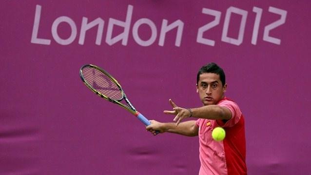 Nicolas Almagro of Spain returns a shot