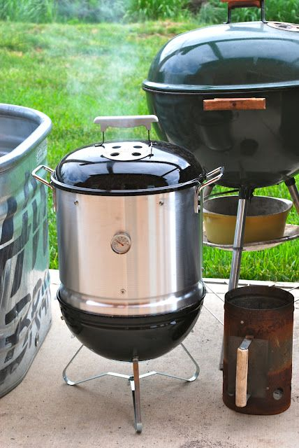 DIY smoker made from a charcoal grill and a steamer pot.
