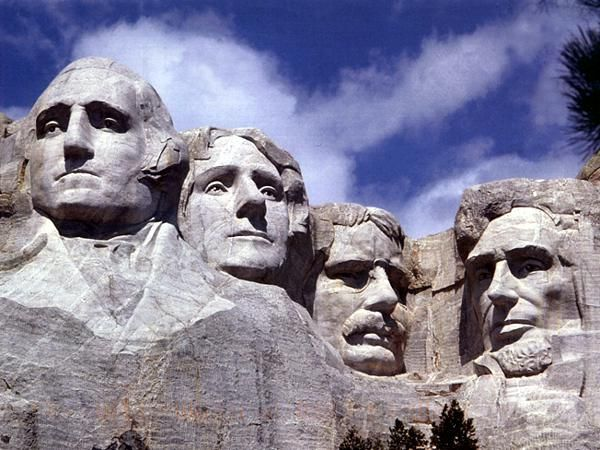 The Mount Rushmore National Memorial is a sculpture carved into the granite face of Mount Rushmore near Keystone, South Dakota, in the United States. Sculpted by Danish-American Gutzon Borglum and his son, Lincoln Borglum, Mount Rushmore features 60-foot sculptures of the heads of four United States presidents: George Washington, Thomas Jefferson, Theodore Roosevelt and Abraham Lincoln.