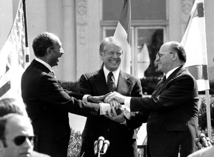 Egyptian President Anwar Sadat, left, President Carter, center, and Israeli Prime Minister Menachem Begin clasp hands on the North Lawn of the White House in Washington after signing the peace treaty between Egypt and Israel in this March 26, 1979 black-and-white file photo. Secretary of State Condoleezza Rice is looking to the past for lessons on how to make next month's planned Mideast peace conference a success. (AP Photo/ Bob Daugherty, File) AP1979