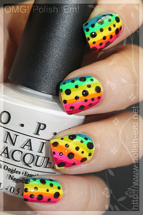Rainbow nails :) cute!!!!! but the fact that she is holding white nail polish......when there is no white on the nails.......