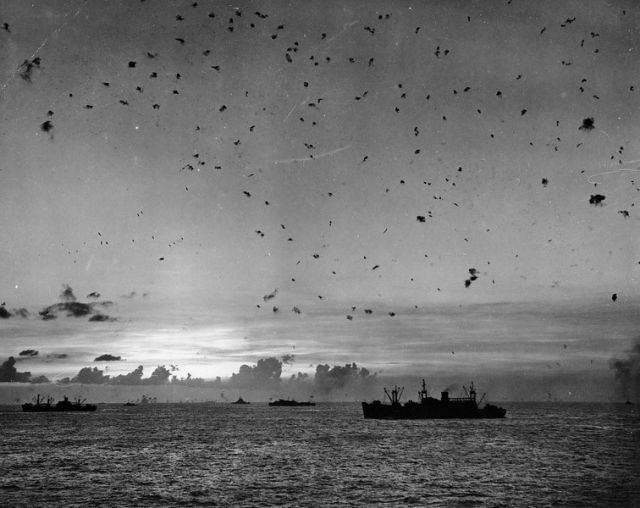 """""""July 27, 1944: Flak fills the sky as U.S. antiaircraft guns fight off a Japanese attack during the invasion of Saipan, Mariana Islands"""