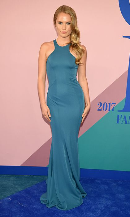 Up and coming model Sailor Brinkley Cook chose a teal halter dress for the night.