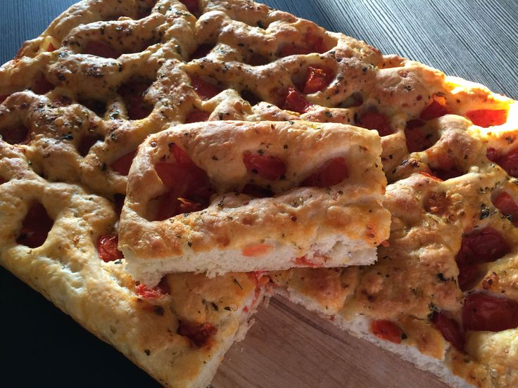 Soft Focaccia Pugliese, flavored with tomatoes, oregano and extra virgin olive oil.