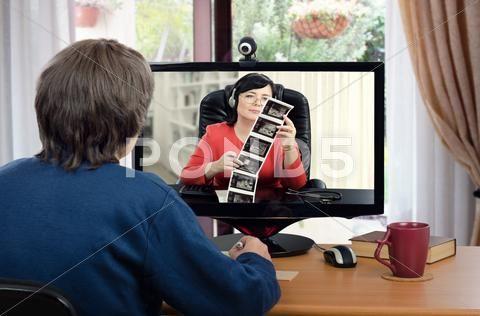Telemedicine doctor examines patients mammogram online - Stock Photo | by verbaska