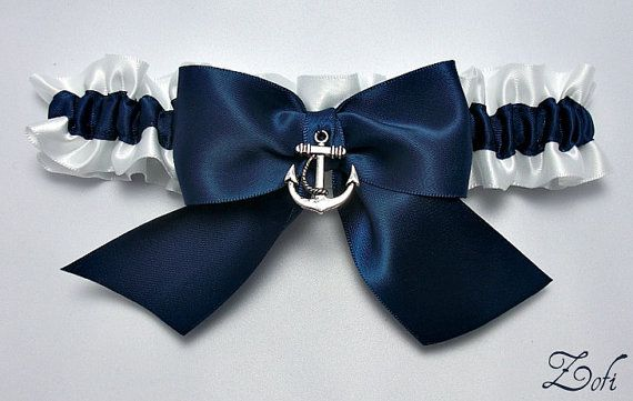 Garter single in white and navy blue satin with a navy blue satin bow and silver anchor charm