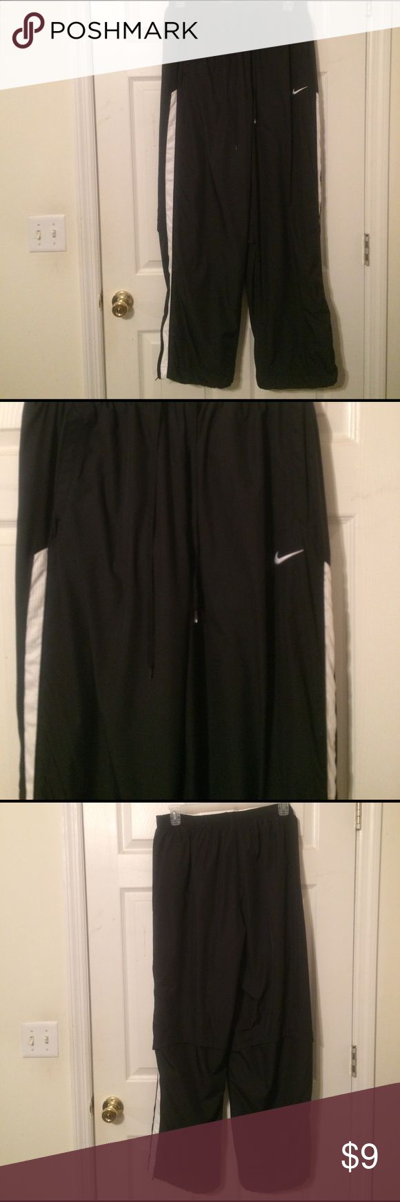 Nike Men's Pants Size XXL Nike Men's Pants Size XXL.  Black with white stripes on the sides of both legs.  Great used condition.  Pants are lined and have zippers at bottom of both legs.  No rips, snags, stains or any damage.  Nice pair of Nike pants that need a new home😊 Questions and offers welcomed!  Thanks for looking 😊 Nike Pants Sweatpants & Joggers