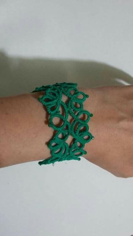 Braccialetto verde tatuaggio