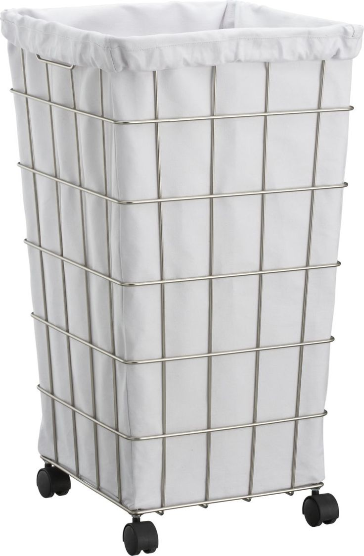 Tapered hamper in heavy-gauge steel wire rolls on black casters to sort and transport laundry.  Washable white canvas liner has a drawstring closure and carrying strap. SteelMatte nickel finishPlastic castersMachine wash 100% cotton canvas linerMade in Taiwan.