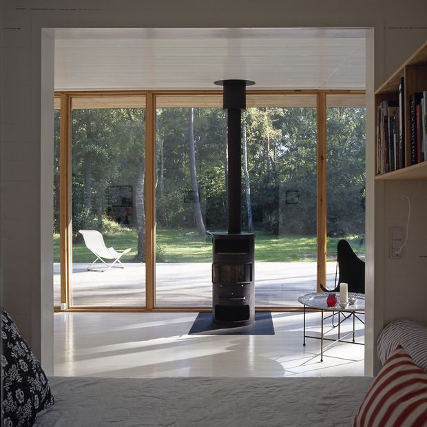 glass walls, modern wood stove. Asserbo house by Christensen & Co Architects   OEN